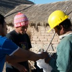 Alan and Henrry handing over dynamite to the community of Maragua